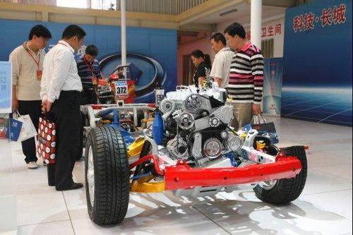 通过视频,展板,实物等形式展示了长城汽车在传统能源节能方面的成果.