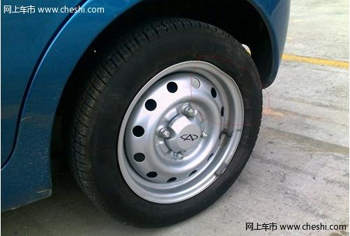奇瑞QQ3新车左轮胎钢圈严重变形高清图片